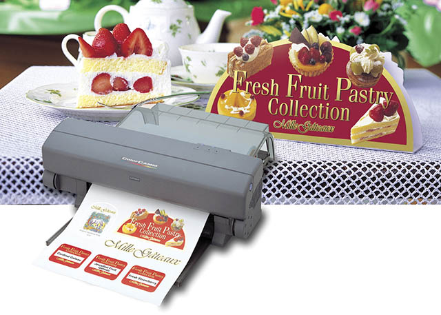 2001 Roland introduces the world's first roll-fed desktop printer/cutter, the ColorCAMM PC-12.